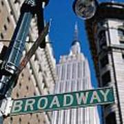 Broadway Sign And Empire State Building Art Print by Axiom Photographic