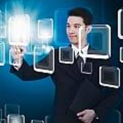 Businessman Pressing Touchscreen Art Print by Setsiri Silapasuwanchai