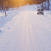 Car On Snow Covered Road Print by Jeremy Woodhouse
