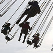Carnival Goers Enjoy A Ride At An Art Print