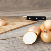 Close Up Of Onions And Knife On Table Art Print