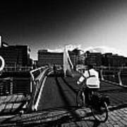 Commuter Cycling Over The Tradeston Bridge Pedestrian Bridge Over The River Clyde To The Financial D Art Print