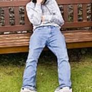 Depressed Teenage Boy On Park Bench. Art Print