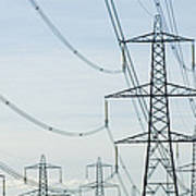 Electricity Pylons Against A Clear Blue Print by Iain  Sarjeant