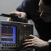 Electronics Technician Troubleshoots An Art Print