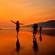 Family Running In The Beach At Sunset Art Print