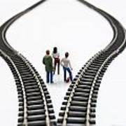 Figurines Between Two Tracks Leading Into Different Directions Symbolic Image For Making Decisions. Art Print by Bernard Jaubert