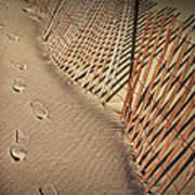 Footprints On The Beach Along A Fence Art Print