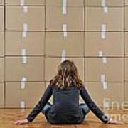 Girl Seated In Front Of Cardboard Boxes Art Print