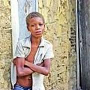 Haitien Boy Leaning On Wall Art Print