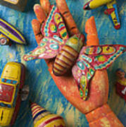 Hand Holding Butterfly Toy Art Print by Garry Gay