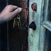Hand Putting Vintage Key Into Lock Art Print