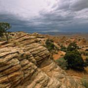 Heavy Clouds Over A Rocky Desert Art Print