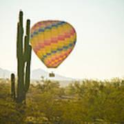 Hot Air Balloon Over The Arizona Desert With Giant Saguaro Cactu Art Print
