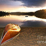 Lake Sunset With Canoe On Beach Art Print by Elena Elisseeva