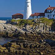 Lighthouse And Rocks Art Print