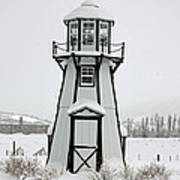 Lighthouse In The Snow Art Print