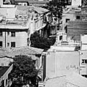 looking down over rooftops to ledra street crossing and  restricted area of the UN buffer zone  Art Print