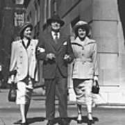 Man And Two Women Walking On Sidewalk, (b&w) Print by George Marks