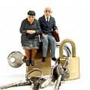 Miniature Figurines Of Elderly Couple Sitting On Padlocks Art Print