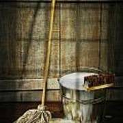 Mop With Bucket And Scrub Brushes Art Print by Sandra Cunningham