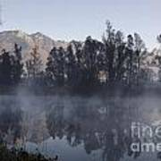 Mountain And Trees Reflected In A Foggy Lake Art Print