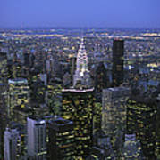 Night View Of The Manhattan Skyline Print by Todd Gipstein