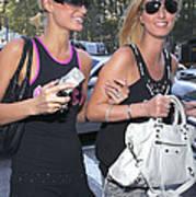 Paris Hilton, Nikki Hilton Carrying Art Print by Everett
