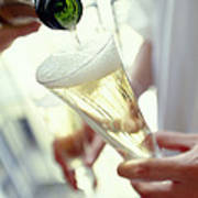 Pouring Champagne Art Print by David Munns