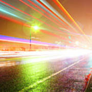Rainy Road With Blurred Traffic At Night Art Print