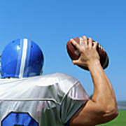 Rear View Of A Football Player Throwing A Football Art Print