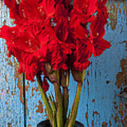 Red Glads Against Blue Wall Art Print