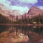 Reflection Of Cabins And Mountains In Art Print