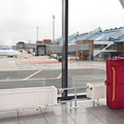 Rolling Luggage In An Airport Concourse Art Print by Jaak Nilson