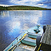 Rowboat Docked On Lake Print by Elena Elisseeva