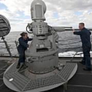 Sailors Conduct Maintenance On The Mk38 Art Print