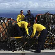 Sailors Prepare Pallets Of Cargo Aboard Art Print