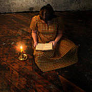 Schoolgirl Sitting On Wood Floor Reading By Candlelight Art Print