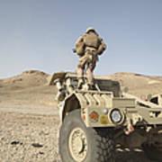 Soldier Climbs A Damaged Husky Tactical Art Print by Stocktrek Images