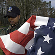 Soldier Unfurls A New Flag For Posting Art Print by Stocktrek Images