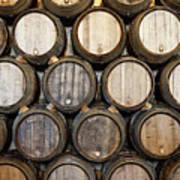 Stacked Oak Barrels In A Winery Art Print by Marc Volk