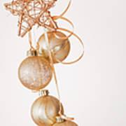 Studio Shot Of Gold Christmas Ornaments Art Print by Daniel Grill