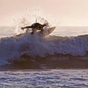 Surfer At Dusk Riding A Wave At Rincon Art Print