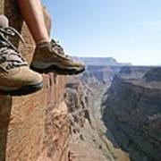 The Boot-shod Feet Of A Hiker Dangle Art Print