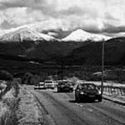 Traffic On A82 Trunk Road Through The Scottish Highlands With Snow Covered Mountains Ben More  Art Print