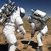 Two Astronauts Collect Soil Samples Art Print by Stocktrek Images