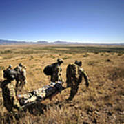 U.s. Air Force Pararescuemen Carry Art Print