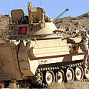 U.s. Army Soldier Jumps Off An M113 Art Print