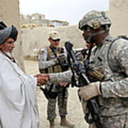 U.s. Army Soldier Shakes Hands With An Art Print
