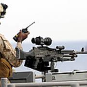 U.s. Marine Talks On A Radio While Art Print by Stocktrek Images